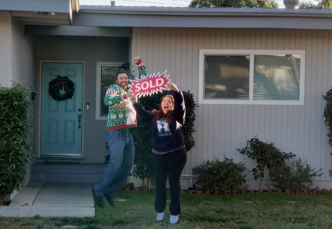 people celebrating the sale of their house